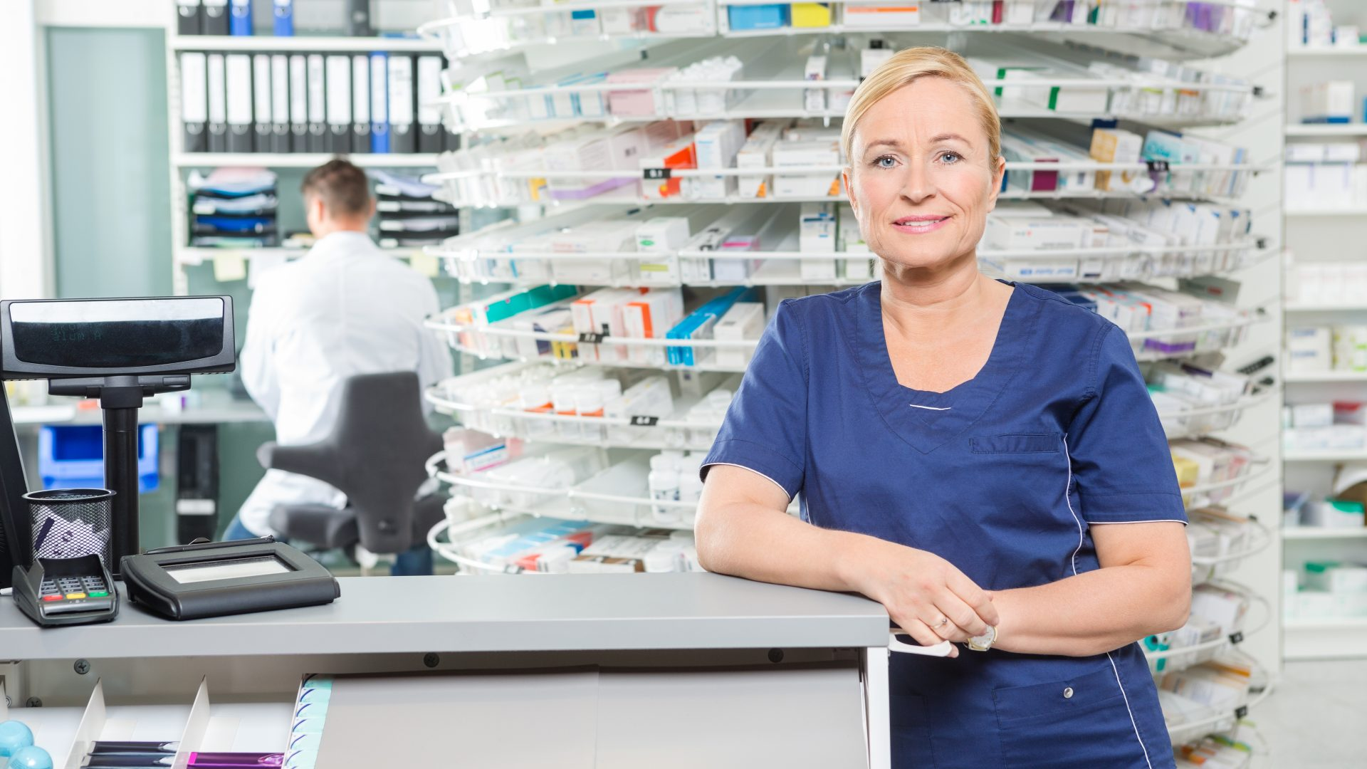 Female pharmacist standing at the counter